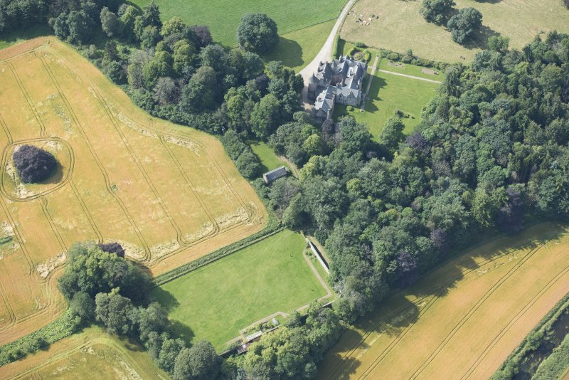Oblique aerial view of Pitcaple Castle, laundry and walled garden, looking S.
