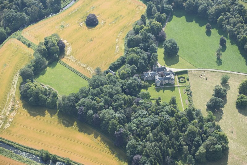 Oblique aerial view of Pitcaple Castle, laundry and walled garden, looking SSE.