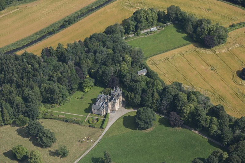 Oblique aerial view of Pitcaple Castle, laundry and walled garden, looking NNE.