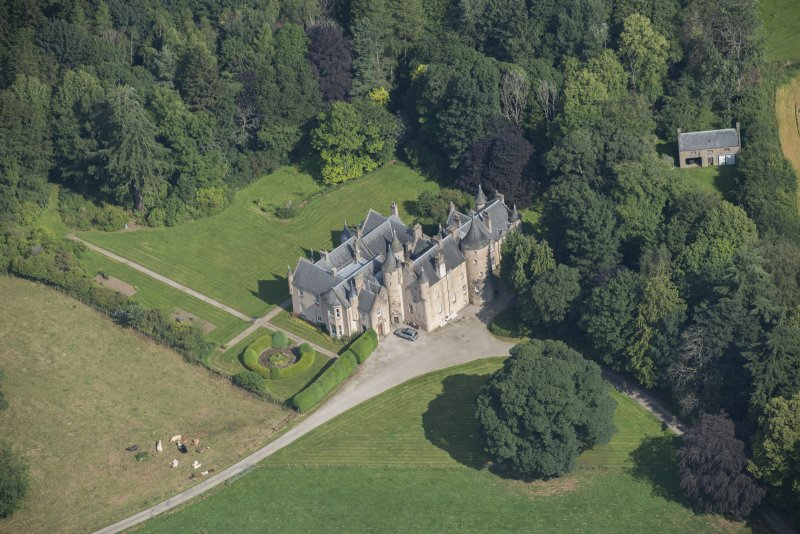 Oblique aerial view of Pitcaple Castle and laundry, looking N.