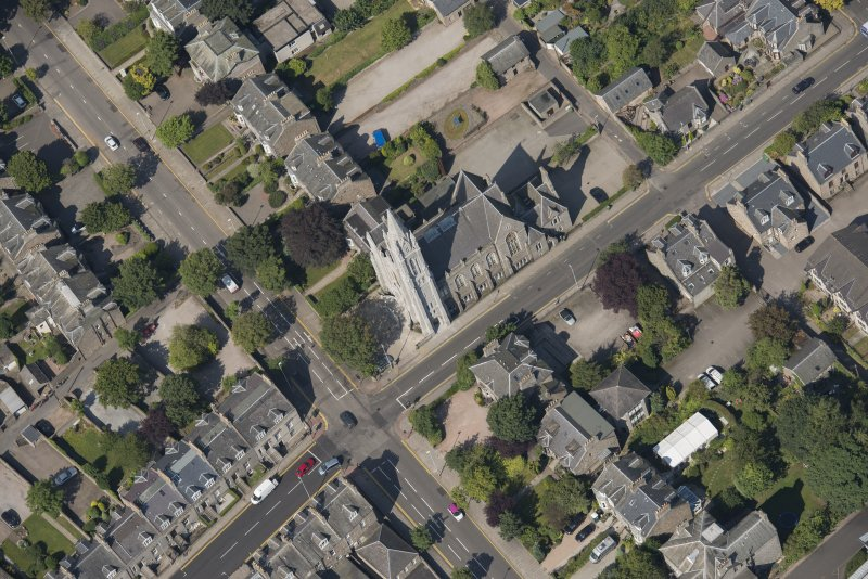 Oblique aerial view of Carden Place United Free Church, looking W.