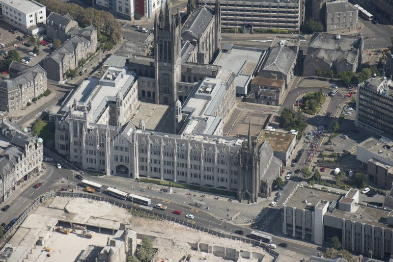 Oblique aerial view of Aberdeen Marischal College, Old St Andrew's Episcopal Church and Greyfriars Church, looking NE.