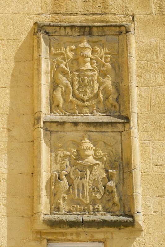 Detail of armorial panels on west face of stair tower.