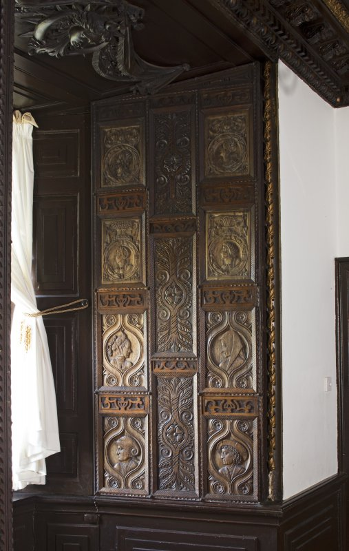 1st floor. Dining room. Detail of carved panelling in window recess.