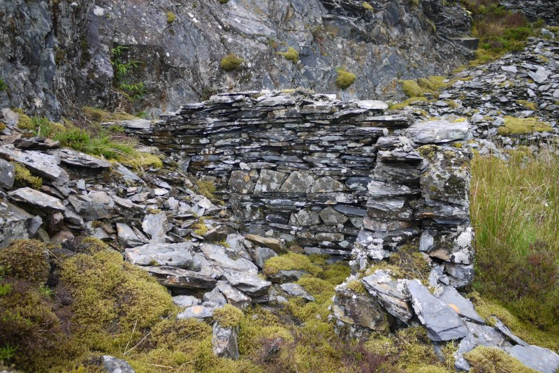View of outbuilding of drystone slate construction from south