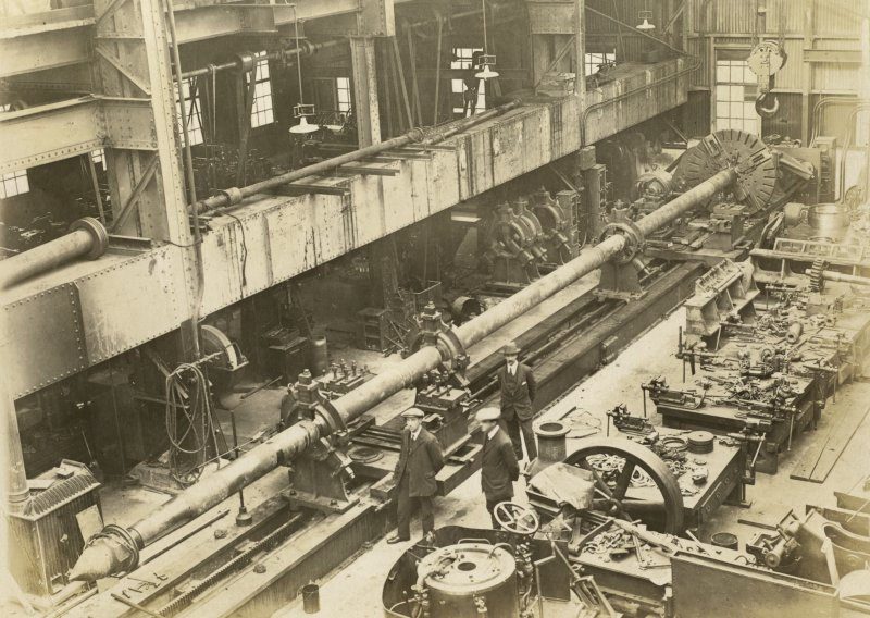 Fitting shop. Mr Lyle, Mr Hodds, Corn Hocken. British destroyer HMS Wakeful's tail shaft.