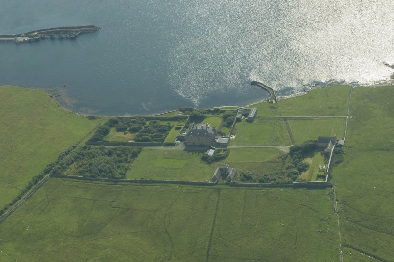 Oblique aerial view of Gardie House, Bressay, looking SW.