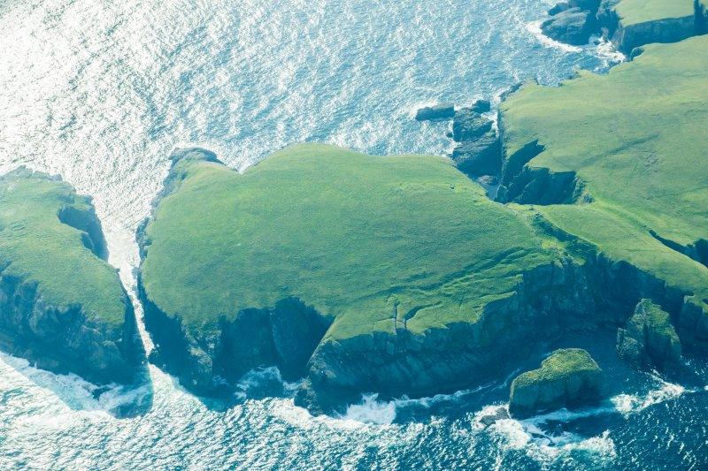 Oblique aerial view of Strandburgh Ness, Outer Brough, Fetlar, looking SSW.