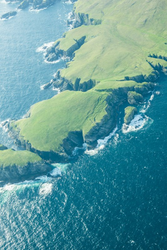 Oblique aerial view of Strandburgh Ness, Outer Brough, Fetlar, looking SSE.