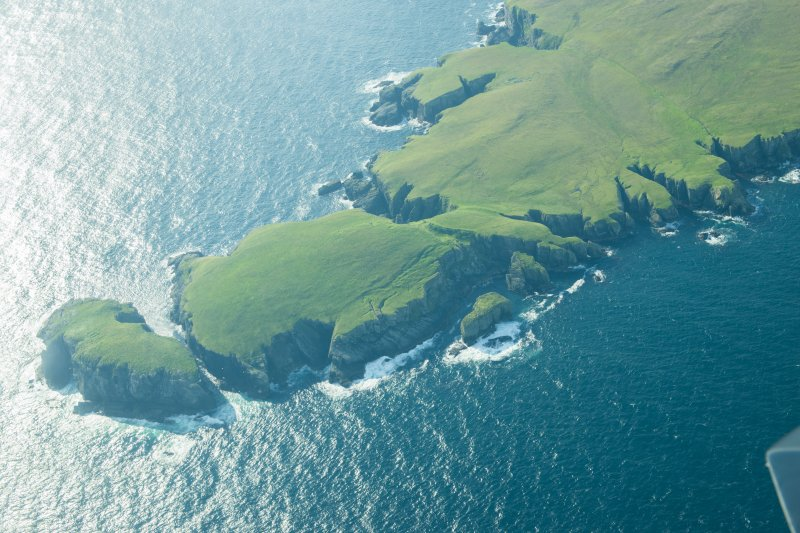 Oblique aerial view of Strandburgh Ness, Outer Brough, Fetlar, looking SE.