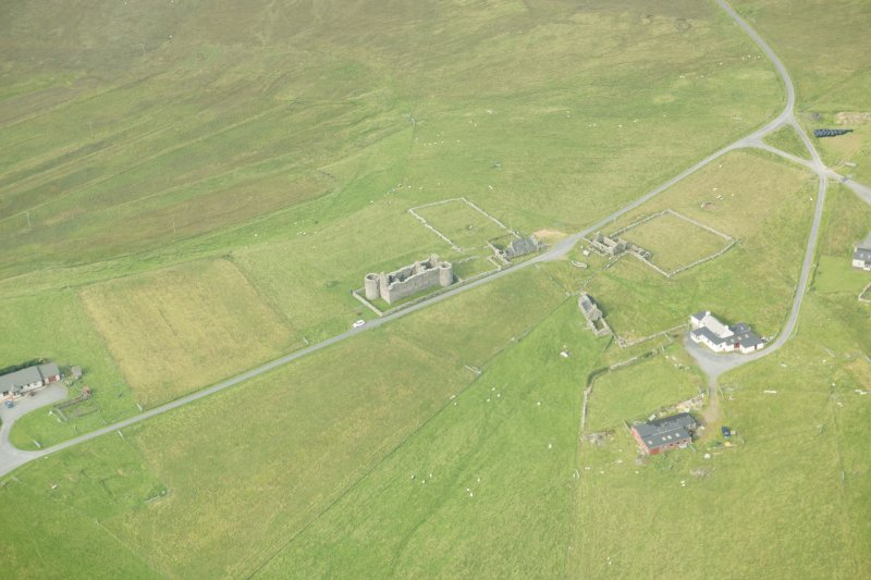 Oblique aerial view of Muness Castle, Unst, looking W.