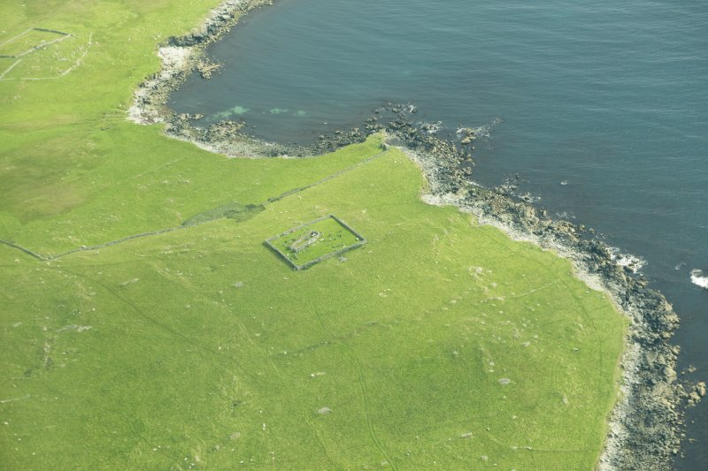 Oblique aerial view of Framgord Chapel, Sandwick, looking NW.