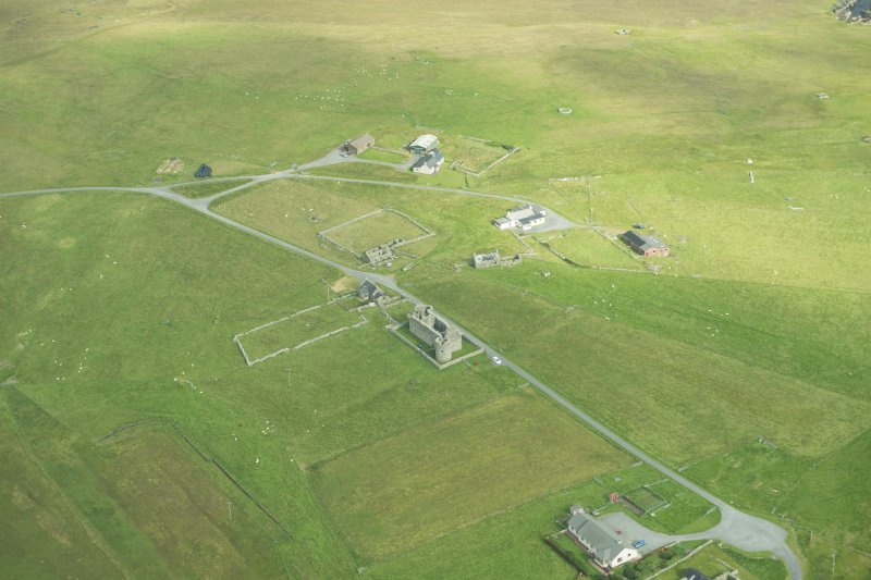 Oblique aerial view of Muness Castle, Unst, looking N.