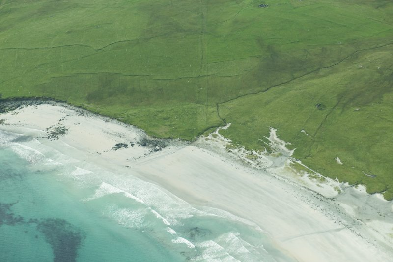 Oblique aerial view of Sandwick, Unst, looking SSW.