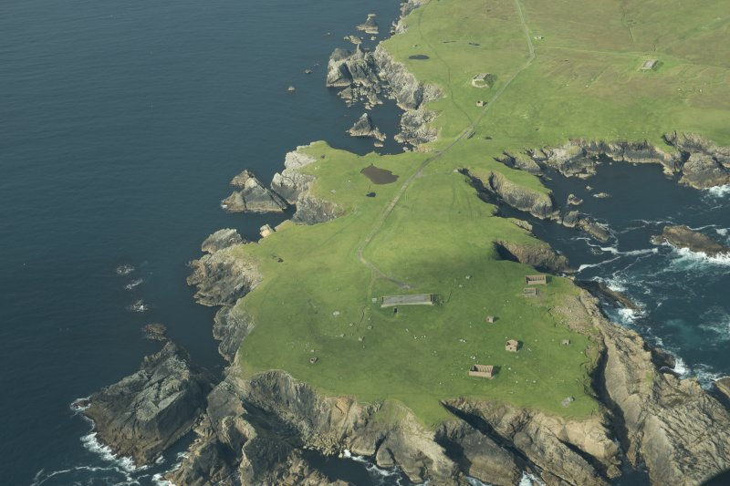 Oblique aerial view of Horns of The Garths, Skaw, Unst, looking WSW.