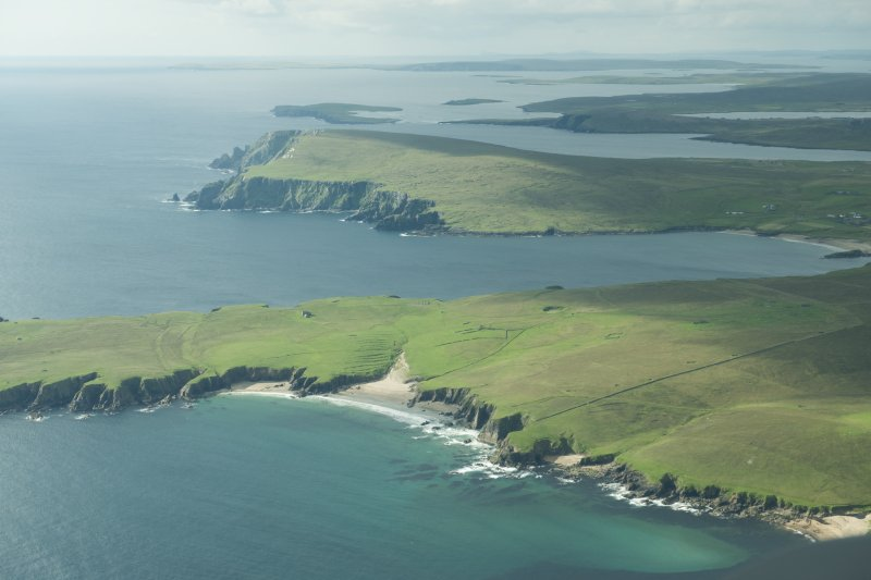 Oblique aerial view of The Garths, Unst, looking SSW.