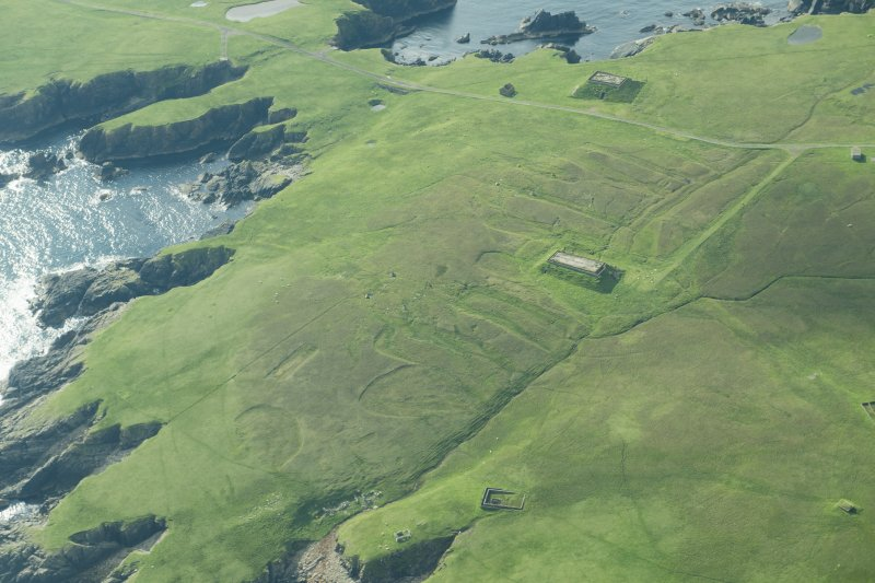 Oblique aerial view of The Garths, Unst, looking SE.