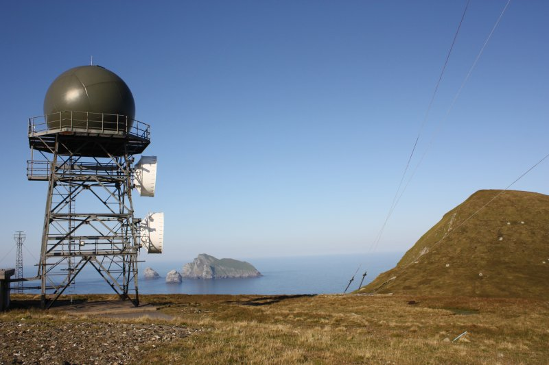 General view of the radar tower at Mullach Mor, St Kilda, with Conachair on the right and Boreray in the distance.