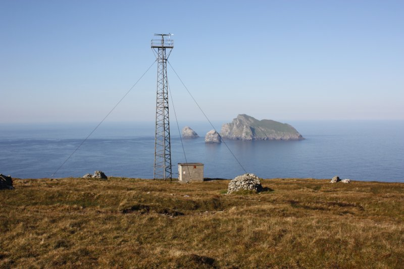 General view of mast at Mullach Mor, St Kilda, with Boreray in the distance.
