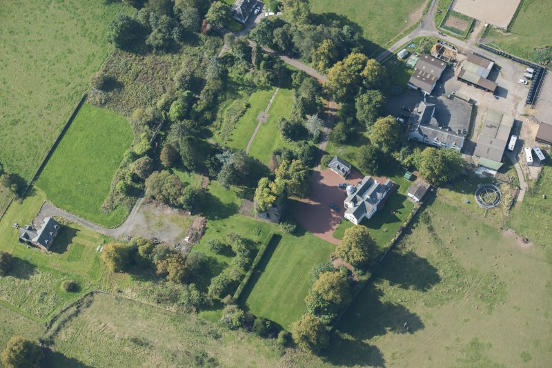 Oblique aerial view of Kilmaronock Castle and Kilmaronock House, looking SW.