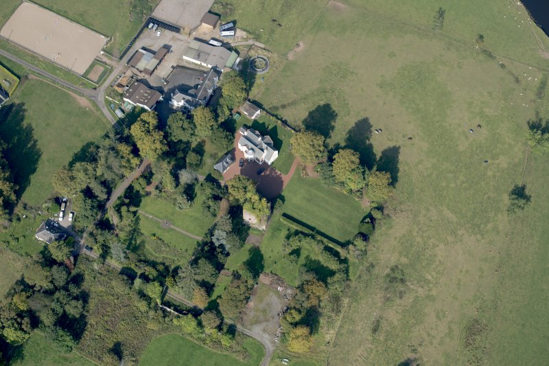 Oblique aerial view of Kilmaronock Castle and Kilmaronock House, looking NW.