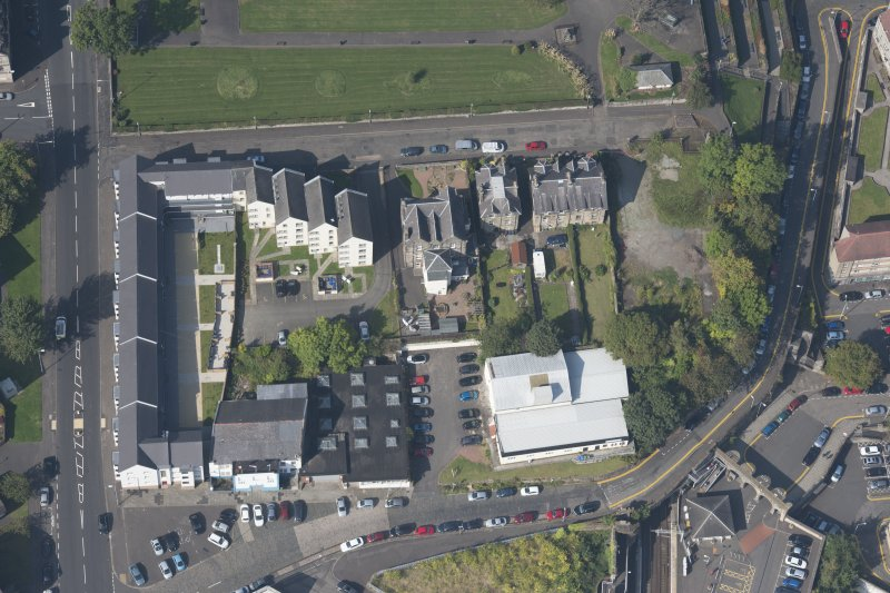 Oblique aerial view of the site of the former Mansion House, loking NW.