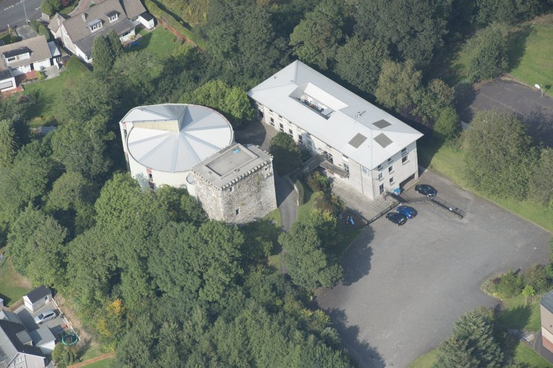 Oblique aerial view of Mearns Castle, looking N.