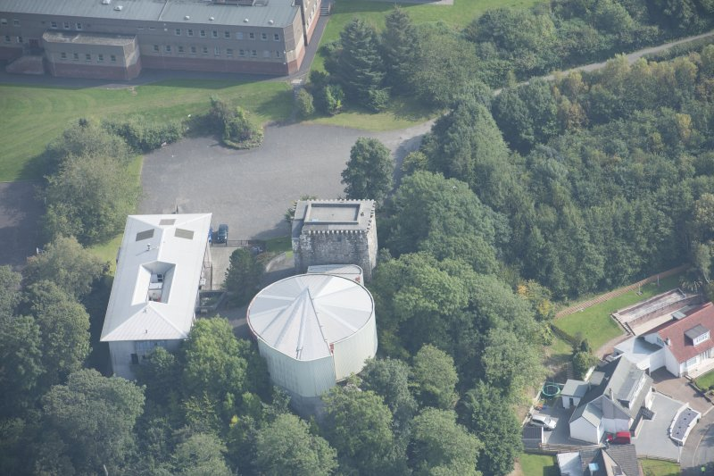 Oblique aerial view of Mearns Castle, looking SE.