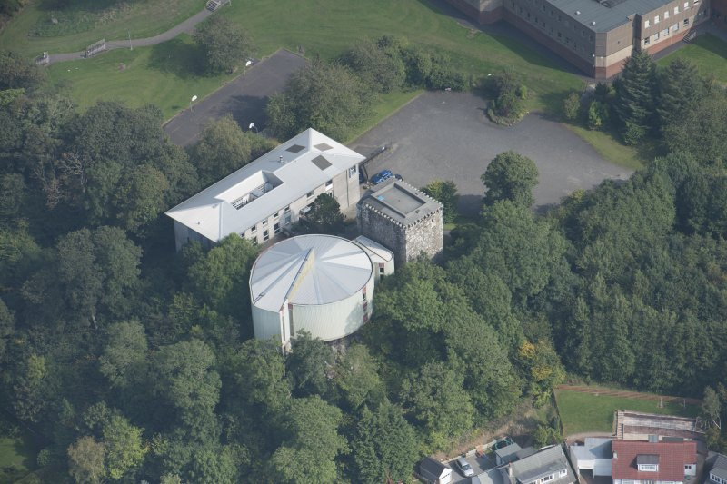 Oblique aerial view of Mearns Castle, looking E.