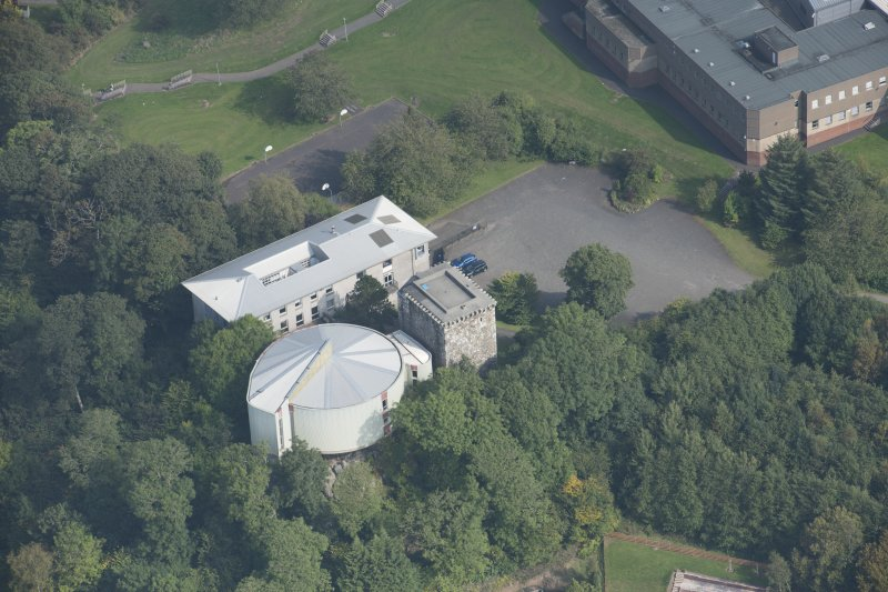 Oblique aerial view of Mearns Castle, looking ENE.