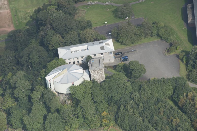 Oblique aerial view of Mearns Castle, looking NE.