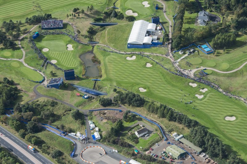 Oblique aerial view of the 16th fairway and green of the 2014 Ryder Cup PGA Centenary Golf Course, looking SW.