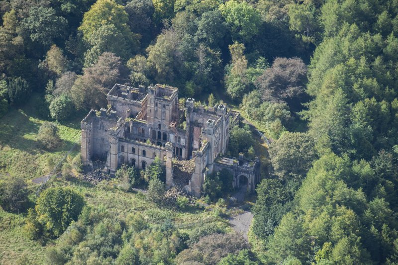 Oblique aerial view of Lennox Castle, looking SW.