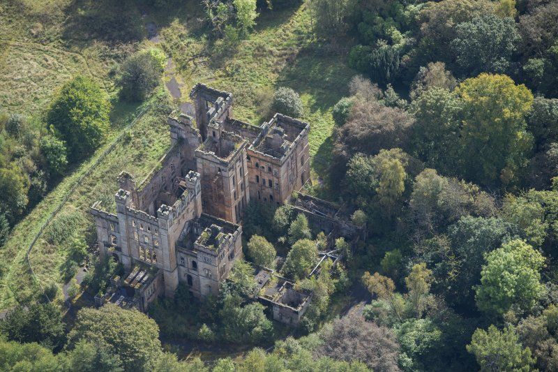 Oblique aerial view of Lennox Castle, looking SE.