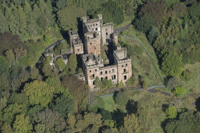 Oblique aerial view of Lennox Castle, looking N.
