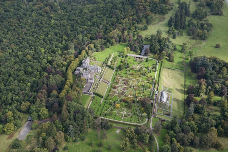 Oblique aerial view of Drummond Castle and formal garden, looking NE.