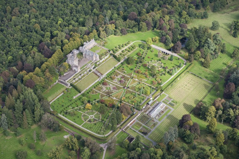 Oblique aerial view of Drummond Castle and formal garden, looking N.
