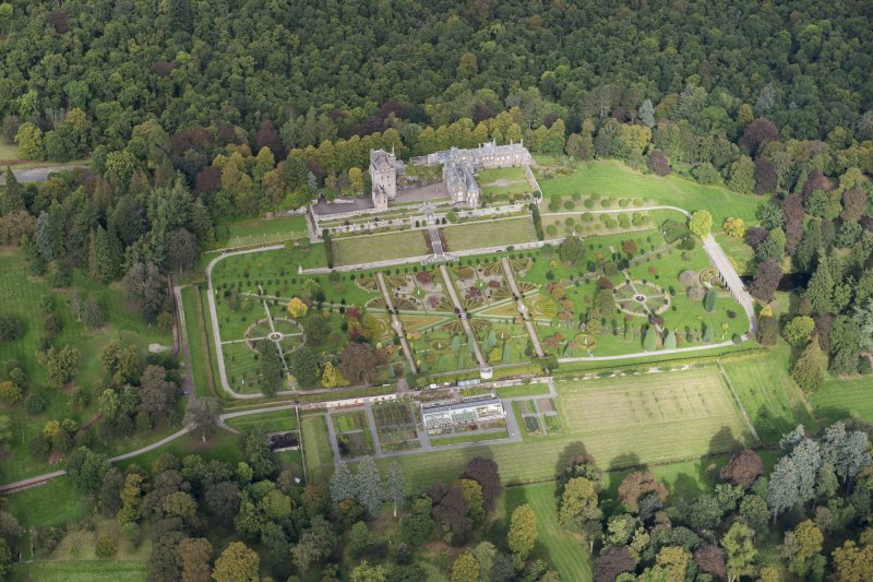 Oblique aerial view of Drummond Castle and formal garden, looking NNW.