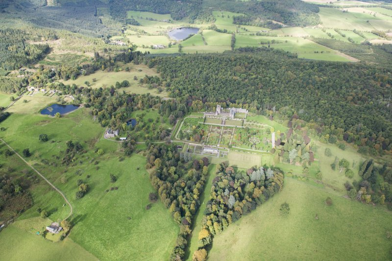 General oblique aerial view of Drummond Castle and formal garden, looking NW.