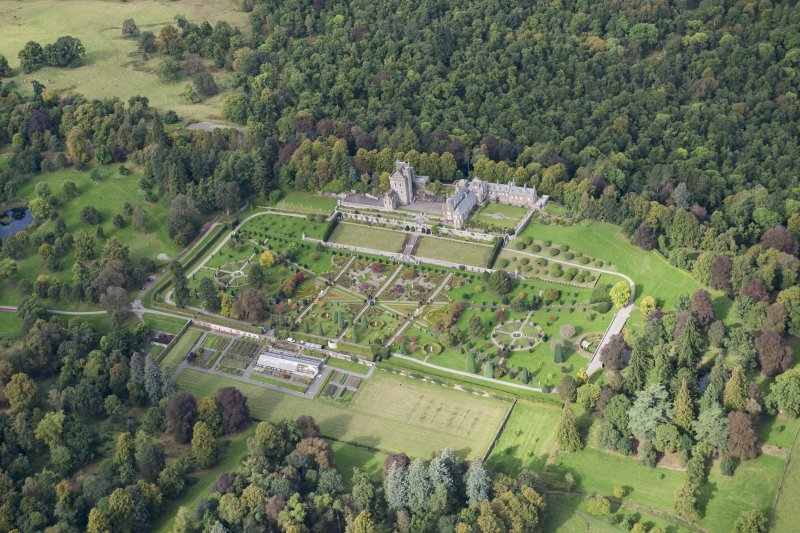 Oblique aerial view of Drummond Castle and formal garden, looking NW.