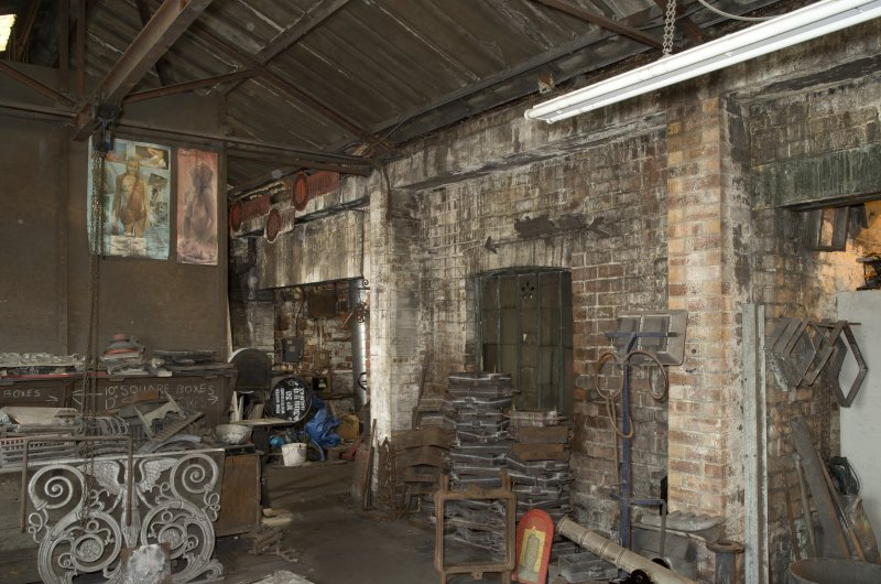 Ground floor, interior view of Brass Shop (or small castings department). This area of the foundry dates from the 1940s. Note the original external wall and window which now forms the dividing wall with the rest of the foundry