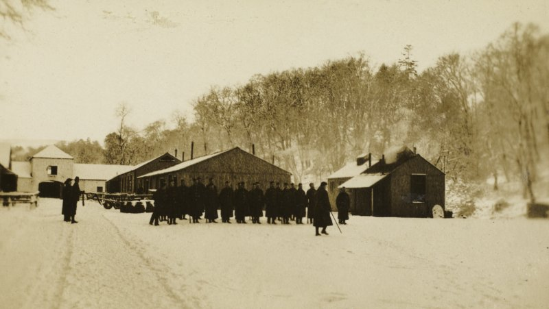 View of soldiers on parade at Stobs Camp by the castle steading.