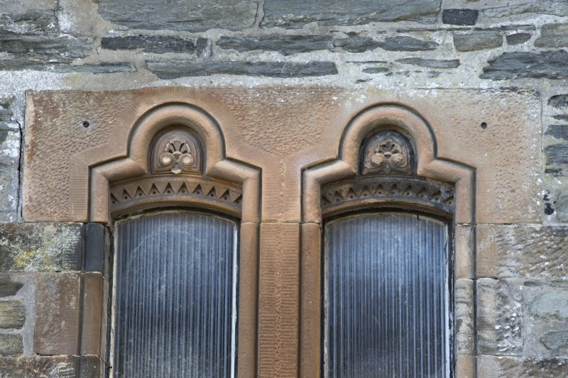 Detail of window pediments to north side of west porch