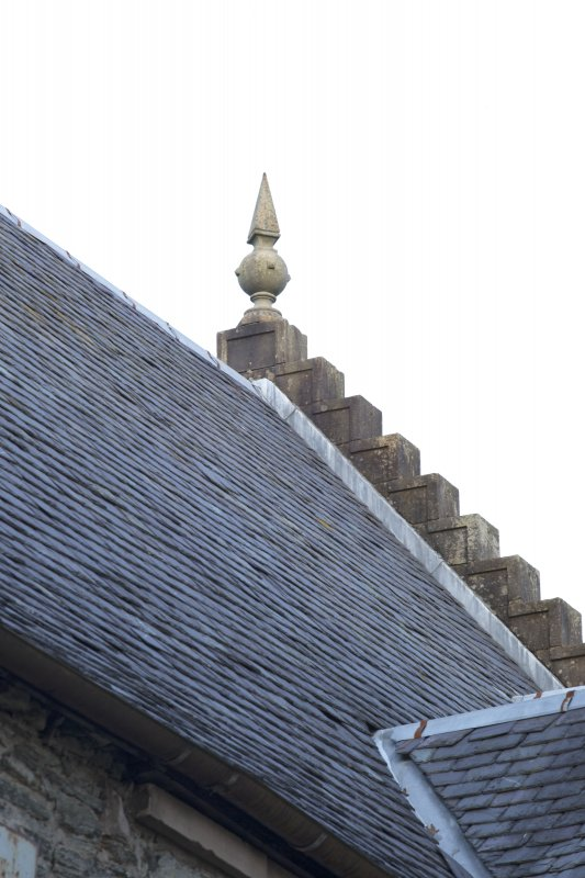 Detail of stone finial on north gable of east elevation