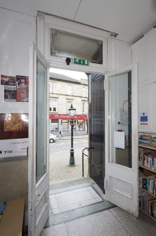 Interior. View looking through main entrance doors to street, taken from west