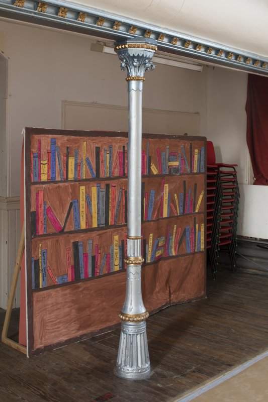 Interior. View of balcony front and supporting column within main hall