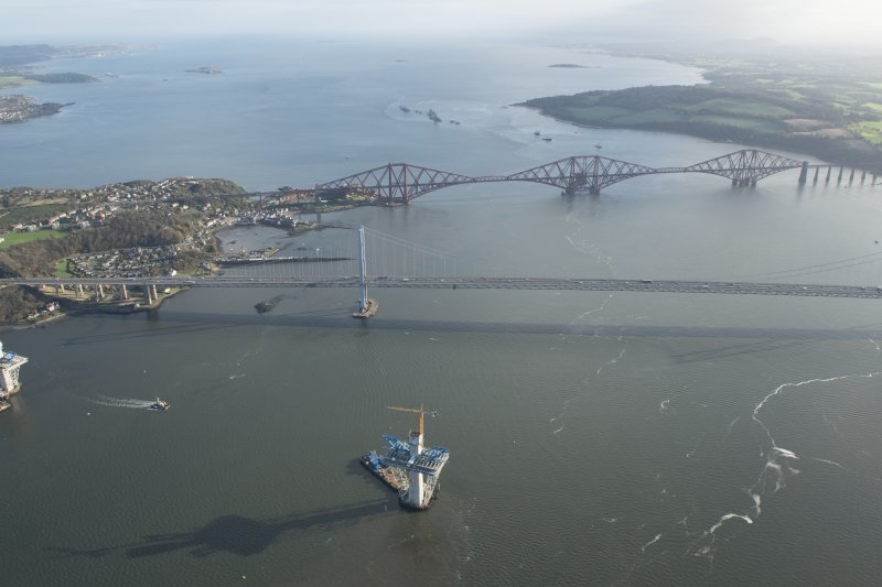 Oblique aerial view of the construction of the Queensferry Crossing and the Forth Bridge, looking E.