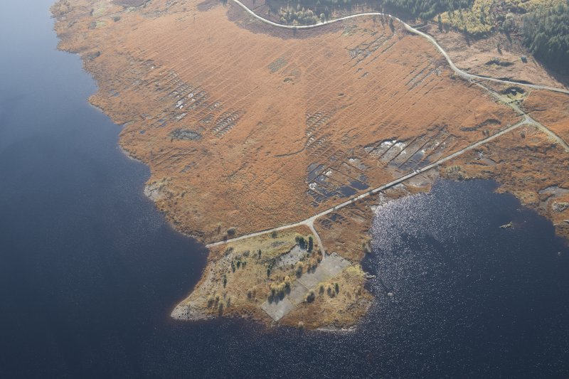 Oblique aerial view of the partially constructed Loch Doon airfield, showing the complex arrangement of field drains used to drain the peaty ground and site of an airplane hanger, looking S.