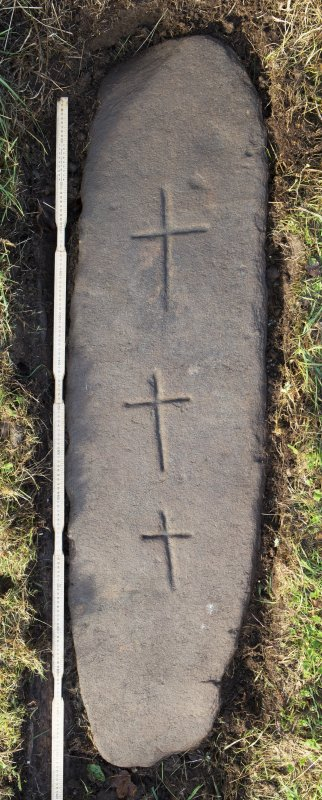 View of recumbent grave slab with three incised crosses (including scale) from St Fillian's Priory, Kirkton