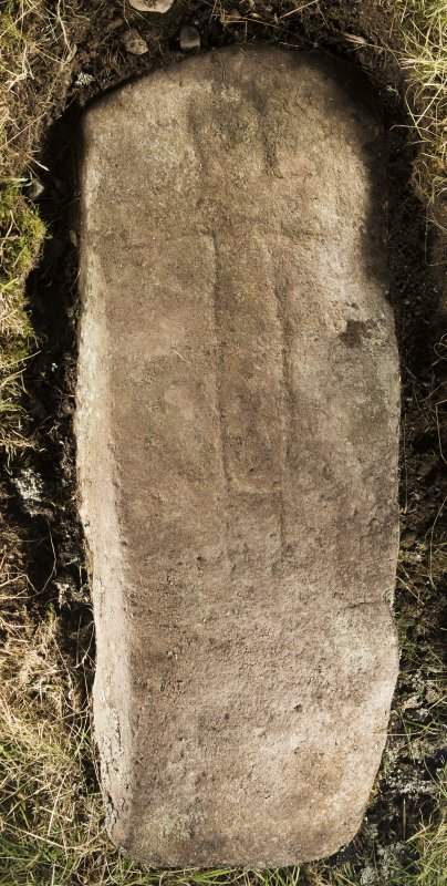 View of recumbent cross slab. Peripheral lighting.